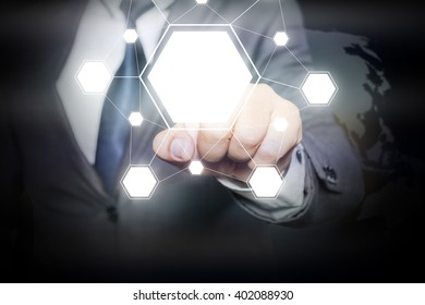 Businessman hand touching  blank icons on virtual screen with  icons linked as network