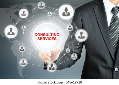Businessman hand touching CONSULTING SERVICES sign on virtual screen