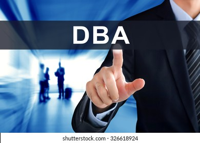 Businessman hand touching DBA (or Doctor of Business Administration) sign on virtual screen - education concept