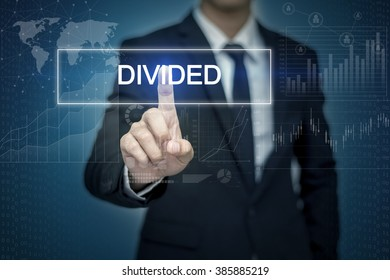 Businessman hand touching DIVIDED  button on virtual screen
