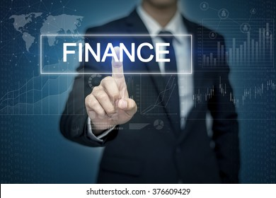 Businessman hand touching FINANCE button on virtual screen
