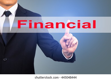 Businessman hand touching FINANCIAL sign on virtual screen