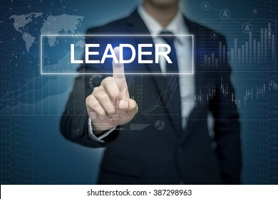 Businessman hand touching LEADER  button on virtual screen
