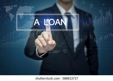 Businessman hand touching A LOAN  button on virtual screen