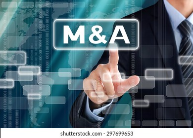 Businessman hand touching M & A (Merger and Acquisition) sign on virtual screen