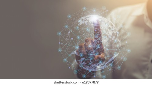 Businessman hand touching map point, network connection, international meaning, copy space / this image furnished by NASA  / soft focus picture / Vintage concept