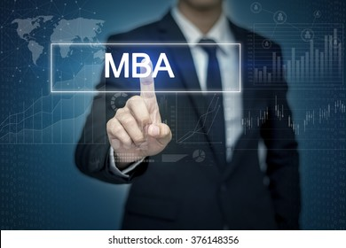 Businessman hand touching MBA button on virtual screen