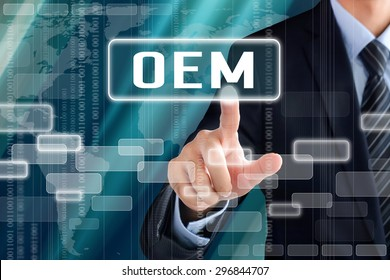 Businessman hand touching OEM ( or Original Equipment Manufacturer) sign on virtual screen
