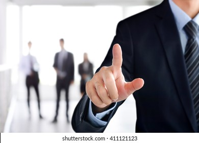 Businessman hand touching on empty virtual screen, modern business user interface (UI) background concept
