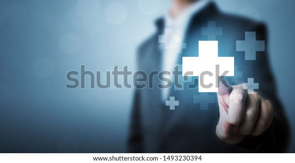 Businessman hand touching plus sign icon means to offer positive thing (like benefits, personal development, social network)