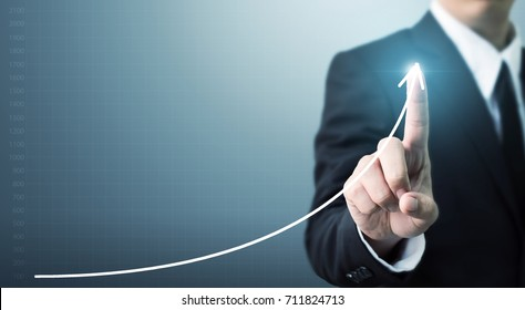 Businessman hand touching point graph growth or increase business chart, Growing up revenue and development concept