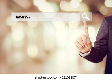 Businessman hand touching search bar with www. over blur background, business and technology concept, search engine optimization, web banner