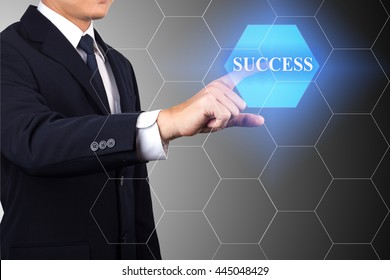 Businessman hand touching SUCCESS sign on virtual screen