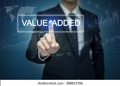 Businessman hand touching VALUE ADDED  button on virtual screen