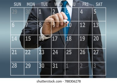 Businessman hand touching virtual panel of calendar planner