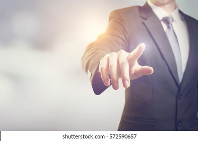 Businessman hand touching virtual screen, modern background concept , can put your text  at the finger, copy space