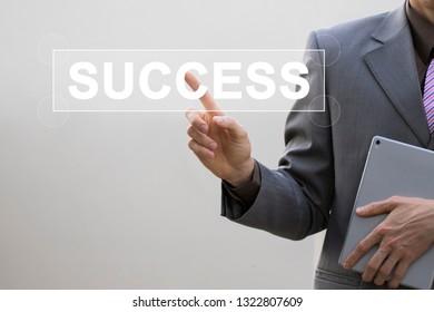 Businessman hand touching word success, Concept internet part to success