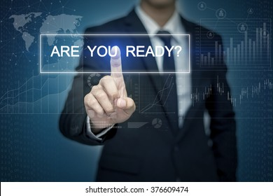 Businessman hand touching ARE YOU READY? button on virtual screen