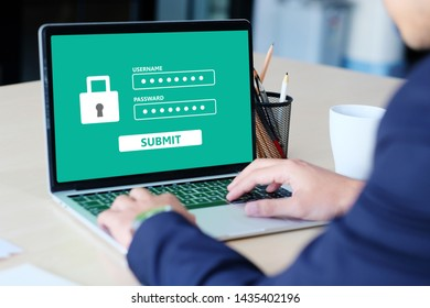 Businessman hand tying laptop computer with password login on screen at office desk, business and cyber security concept