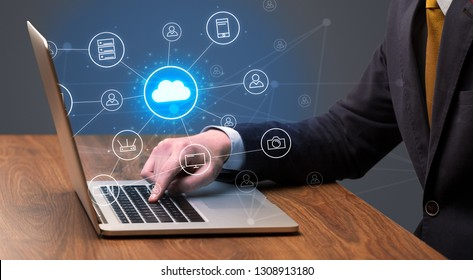 Businessman hand typing with cloud technology system and office symbol concept - Shutterstock ID 1308913180