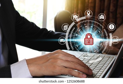 Businessman hand use laptop computer with padlock icon technology, Cyber Security Data Protection Business Technology Privacy concept, Internet Concept of global business.