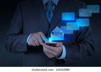 businessman hand use smart phone computer with email icon