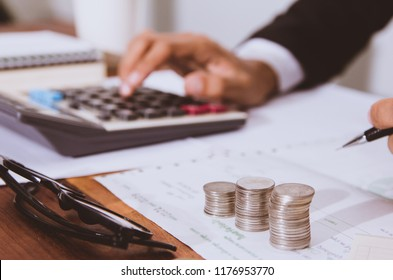 businessman hand using calculator Calculating bonus 