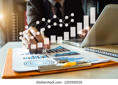 Businessman hand using laptop, tablet and smartphone  in office. Digital marketing media mobile app in virtual icon screen