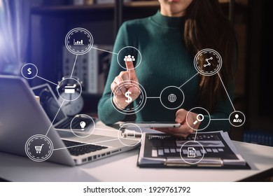 Businessman hand using laptop, tablet and smartphone  in office. Digital marketing media mobile app in virtual icon screen - Shutterstock ID 1929761792