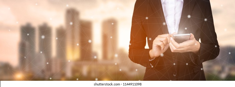 Businessman hand using mobile phone and dots online communication network.