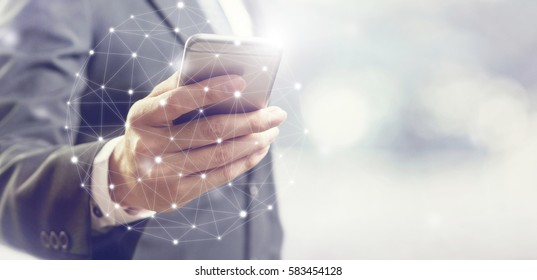 Businessman hand using mobile phone and dots online communication network, copy space