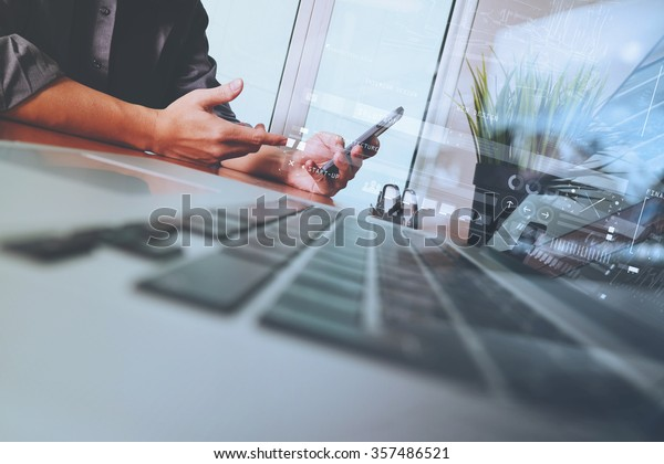 Businessman hand using mobile phone with digital layer effect as business strategy concept