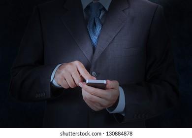 businessman hand using mobile smart phone