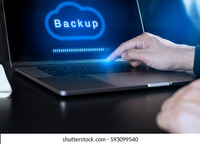 Businessman hand using modern laptop computer to Backup on Cloud