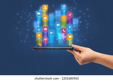 Businessman hand using phone with flying application icons around