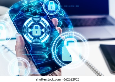 Businessman hand using smart phone protect by cyber security