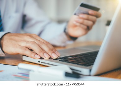 businessman hand using smart phone,mobile a credit card payments online shopping,digital tablet,warm colours sun light