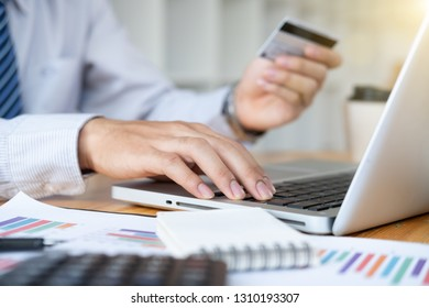 businessman hand using smart phone,mobile a credit card payments online shopping,digital tablet,warm colours sun light.
