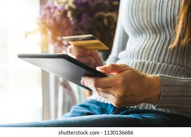 businessman hand using smart phone,tablet payments online shopping,omni channel,digital tablet docking keyboard computer at office in sun light