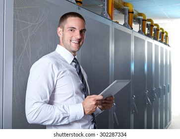 businessman hand using tablet computer in modern server room