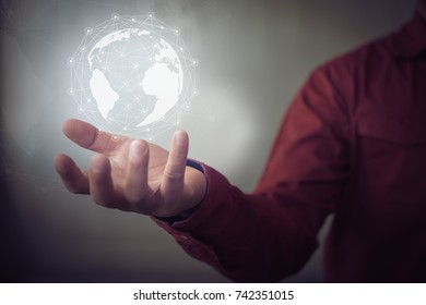 Businessman hand with virtual Earth map and network connection, international meaning