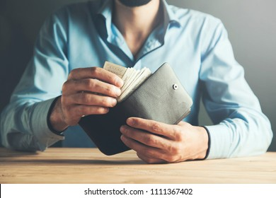 businessman hand wallet with money