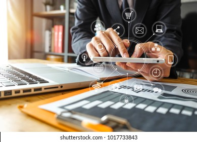 businessman hand working with laptop computer in modern office with virtual icon diagram at modernoffice in morning light