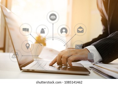 businessman hand working with laptop computer in modern office with virtual icon diagram at modern office in morning light
