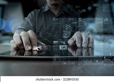 businessman hand working with modern technology digital tablet computer and graphics layer effect as business strategy concept