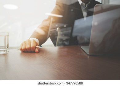 businessman hand working with modern technology and glass of water as business strategy concept
