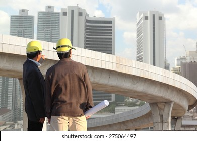 businessman hand working with new big city background and business strategy as concept