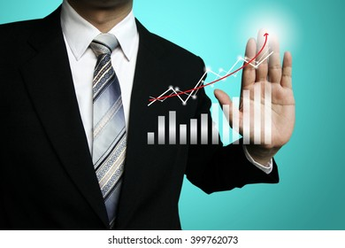 businessman hand working with new modern computer and business strategy  concept, businessman present profit growth chart