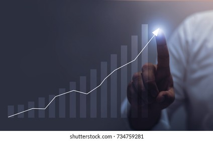 businessman hand working with new modern computer and business strategy as concept  / Blue tone Collection