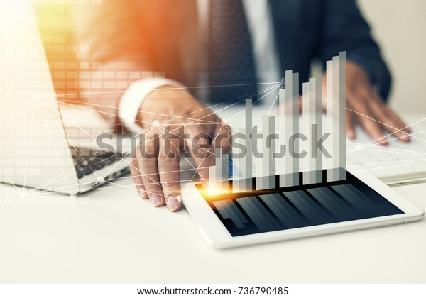 businessman hand working with new modern computer, smartphone and business strategy as concept.